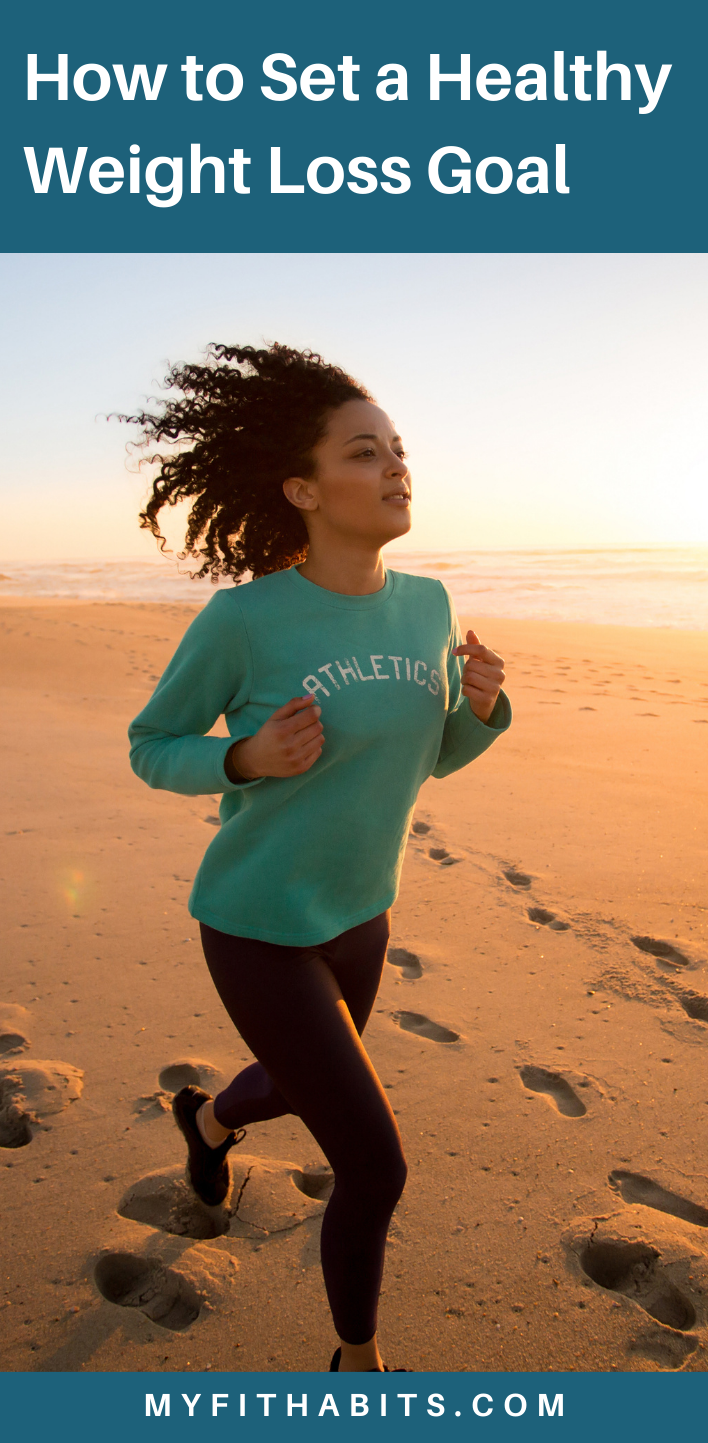 Woman running on the beach, working on weight loss through exercise.